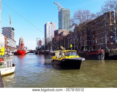 River Traffic Of Boats Between The Waters Of The Canals Of Rotterdam In Holland