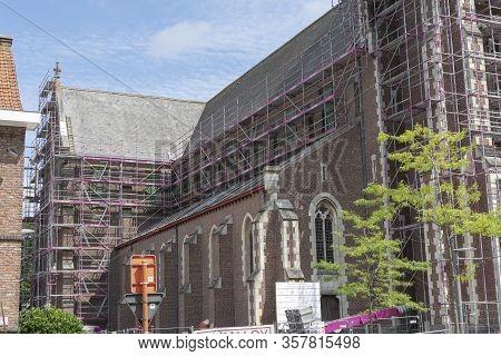 Sint Gillis Waas, Belgium, 16 August 2019 The Side Of The Sant'egidio Church Fully In Scaffolding