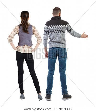 Back view of couple in sweater pointing. Rear view people collection. backside view of person. Isolated over white background.