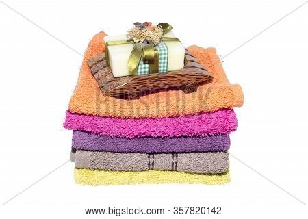 Soap And Dish On Top Of Facecloths Of Various Shades