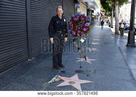 LOS ANGELES - MAR 21: LAPD officer Yest as a wreath is placed at the star of Kenny Rogers on the Hollywood Walk of Fame on March 21, 2020 in Los Angeles, CA. Rogers died late Friday at the age of 81.