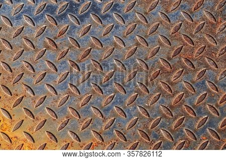 Background Of Rusty Metal Material Texture With A Pattern, Used. Distressed Enamel Metal Surface. We