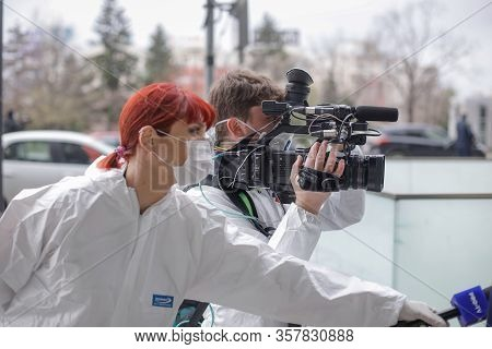 Bucharest, Romania - March 25, 2020: Television Journalists (cameraman And Reporter) Wearing Protect