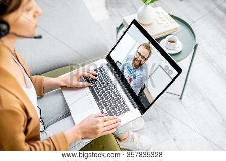 Business Woman Having A Video Call With Coworker, Working Online From Home At Cozy Atmosphere. Conce