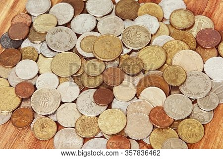 Various Coins Of World Taken Closeup As A Business Background.