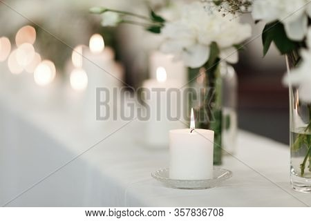 Table Setting At Wedding Reception. Floral Compositions With Beautiful Flowers And Greenery, Candles