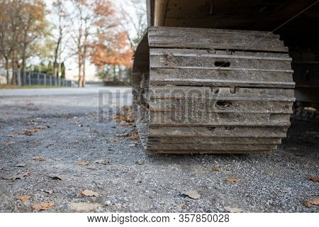 Low Angle Closeup View Of Bulldozer Track Grouser Pad And Roller