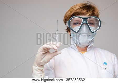 Doctor With A Vaccine In Syringe. Stock Photo Portrait