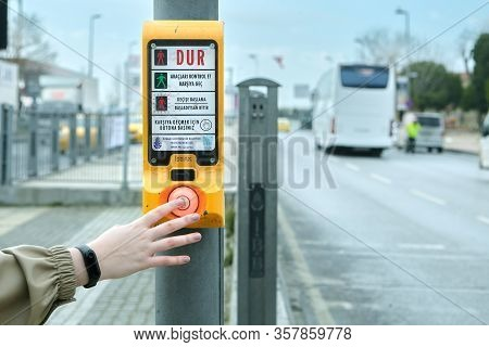 Istanbul, Turkey - February 11, 2020: A Female Hand Presses On The Transition Push Button For Pedest