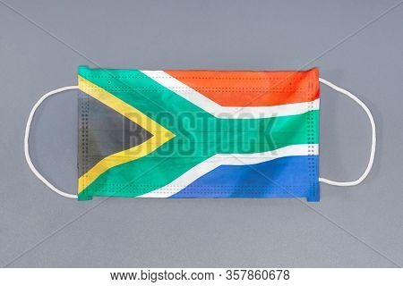 Isolated Medical Mask With Flag Of South Africa On Gray Background. Closeup Protective Masks Textile