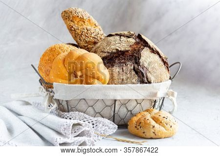 Bread In A Basket With Rolls. Fresh Bakery. Beautifully Folded Black And White Bread In A Metal Bask