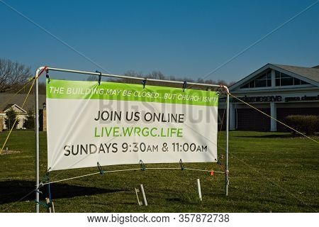 Macedonia, Oh, Usa - March 25, 2020: A Church Banner Advertises Online Services During Closure Of In