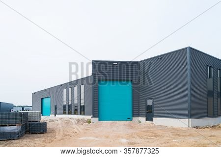 Exterior Of A New Commercial Warehouse Under Construction