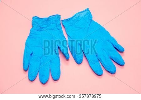 gloves on the background, protection against coronavirus. Respiratory mask and latex gloves and goggles for the face - necessary attributes during the epidemic covid- 19