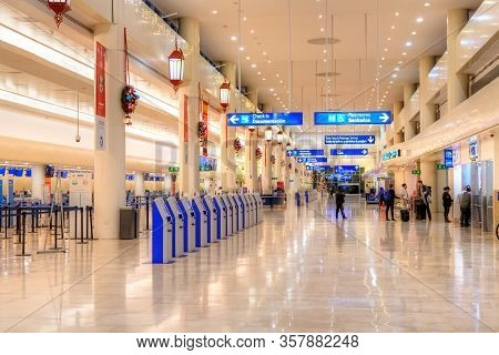 Cancun, Mexico - Dec. 28, 2019: Passengers At The Departure Hall Of Cancun International Airport In