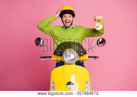 Portrait Of His He Nice Attractive Lucky Glad Cheerful Cheery Guy Riding Moped Holding In Hand Clock