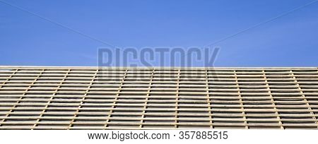 Covered With Water-proof Materials, The Roof Of The Building Is Covered With A Rigid Frame Of Boards