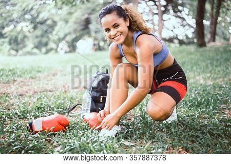 Sporty Woman Tying A Shoelaces At Public Park,women Athlete Preparing For Jogging Or Run