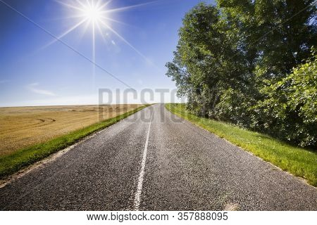 Asphalt Road On The Bend, Sunny Weather With Blue Sky