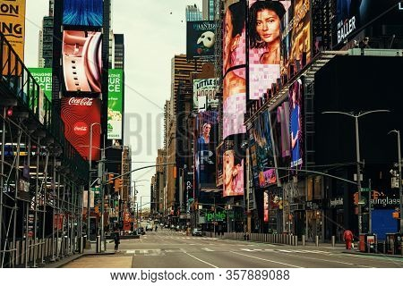 NEW YORK, USA - MARCH 21, 2020: Empty Times Square street with few pedestrians and traffic as the result of COVID-19 coronavirus pandemic outbreak in New York City.