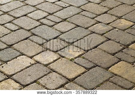 Two-tone Cobblestones On The Pavement For Pedestrian Traffic, Close - Up In The Park
