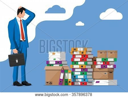 Stressed Businessman And Pile Of Office Folders, Documents. Overworked Business Man With Stacks Of P