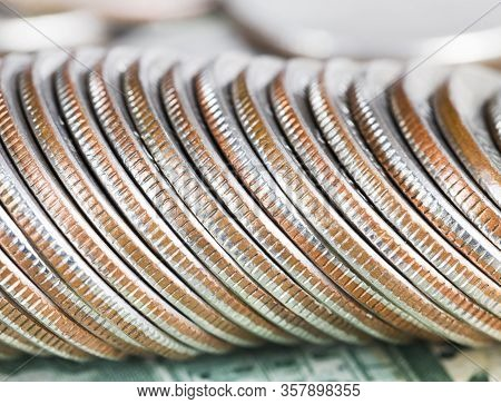 A Stack Of Old American Quarter Dollar Coins, A Close-up Of Metal Money With Flaws And Defects Worth