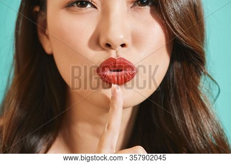 Asian Woman With Index Finger On Lips, Ask To Be Quiet. Silence And Secret Concept