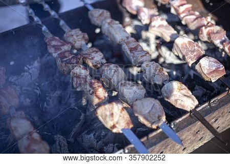 Charcoal Food. Barbecue Grilled On Charcoal. The Meat Is Smoked In Mongal. Armenian Skewers Cooked O