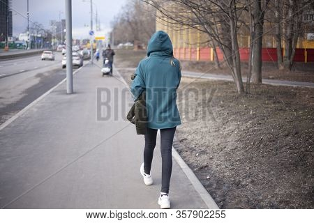 A Girl Is Walking Around The City. A Teenager Walks Alone. Unknown Person In The Hood. The Man Did N