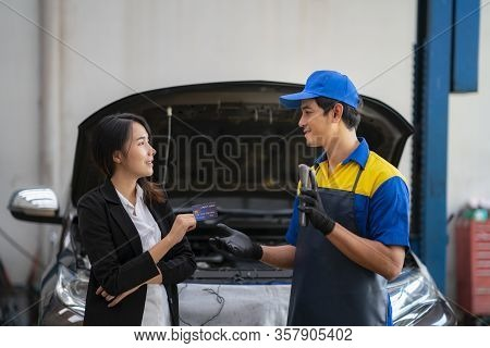 Asian Girl Pay A Car Repair Cost By A Credit Card, In Ca Cervice Center