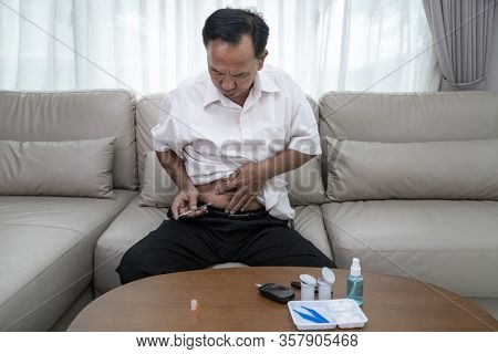 Asian Old Man Test Diabetes Check And Injec Insulin By Him Self In His Home.