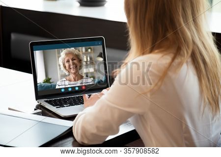 Happy Middle Aged Woman Making Video Call With Young Daughter.