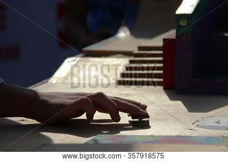 Teen Hand Playing The Fingerboard, Close-up. Freestyle And Hurdles. Finger Skateboard Fingerboard Mi