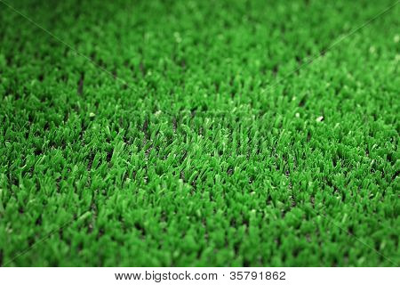 backgrounnd of artificial green grass