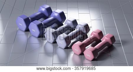Dumbbells Various Weight And Colors On Tiled Floor. 3D Illustration