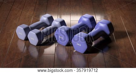 Dumbbells Various Weight And Colors On Wooden Floor. 3D Illustration