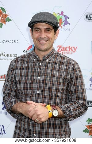 LOS ANGELES - NOV 13:  Ty Burrell at the 13th Annual Day Of The Child at the Star Eco Station on November 13, 2011 in Los Angeles, CA