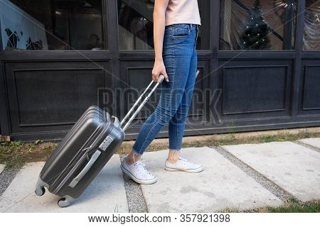 Woman With Travel Trolley Luggage In Hotel Lobby.travel Concept.