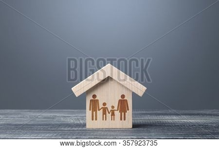 Drawing Symbol Of A Family In A House. Mortgage Loan. Providing The Population With The Possibility