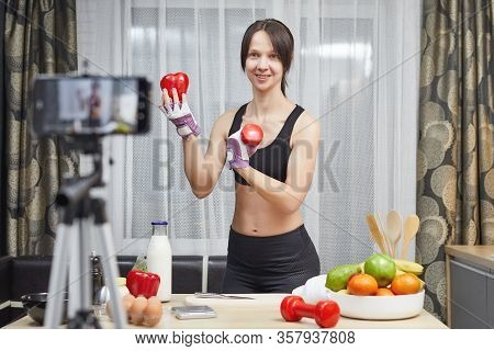 Woman Healthy Blogger Is Showing Apple Fruite And Clean Diet Food. Vlogger Recording Vlog Video Live