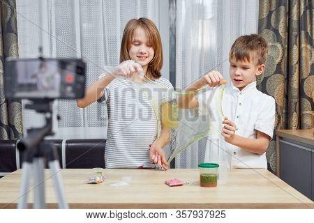 Blogger Kid Posing For Recording Homemade Video To Vlog. Children Make Vlog About Slime For Social M