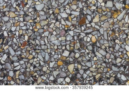 Stone Aggregate Flooring After Rain Giving Deep Tones For A Background.