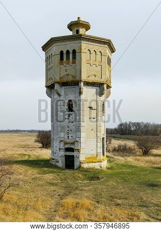 Old Abandoned Beton Water Tower In Steppe Near Stavropol, Russia, Built In 1910s