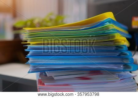 Pile Or Stack Of File Folders With Documents Binder On Desk Office. Storage Archive In Business Admi
