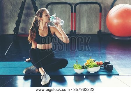 Healthy Lifestyle Woman Drink Water At Fitness Gym. Young People Girl Workout Exercise Body For Diet