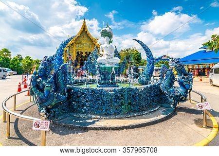 Chiang Rai, Thailand - 6.11.2019: Fountain With Statue Of Buddha Near The Blue Temple (wat Rong Suea