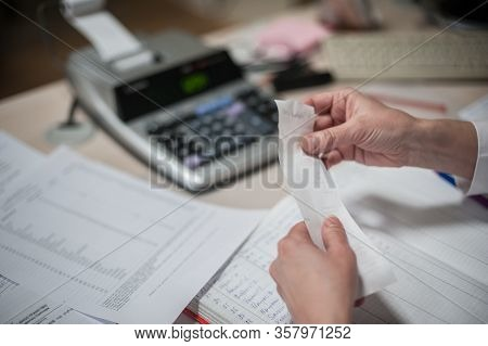 Close-up Of Female Accountant Hands Calculates And Research Financial Data