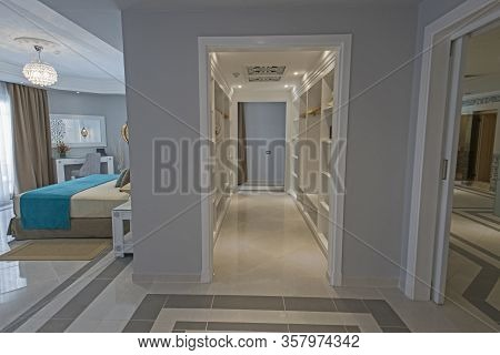 Interior Of Master Suite Luxury Hotel Room With Large Walk In Wardrobe Closet And Bathroom