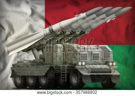 Tactical Short Range Ballistic Missile With Arctic Camouflage On The Madagascar Flag Background. 3d